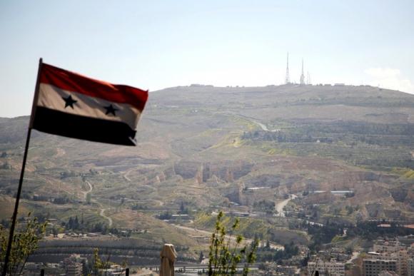 Bandera siria en Damasco. Foto: Reuters.