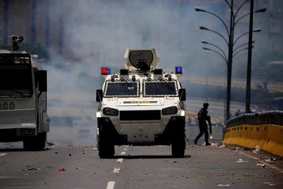 Disturbios en Venezuela tras la marcha opositora. Foto: AFP
