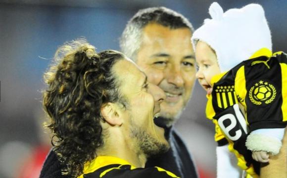 Diego Forlán con Martín