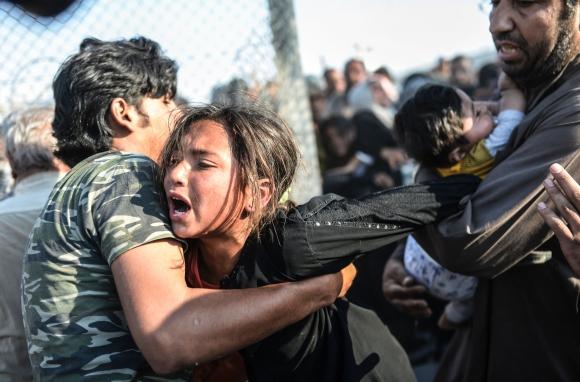 Otra imagen de Bulent Kilic en el campo de refugiados. Foto: AFP