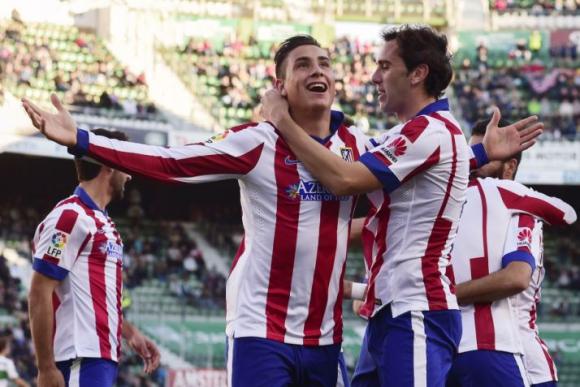José María Giménez celebran el gol del primero ante Elche. Foto: AFP.
