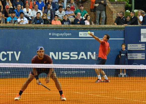 Almagro y Russi en el debut en dobles