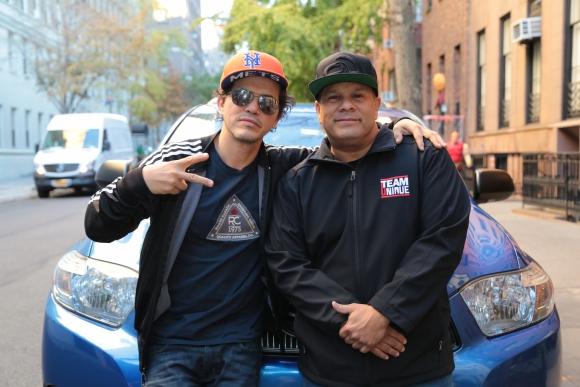 Will Castro con el actor, productor y guionista John Leguizamo.