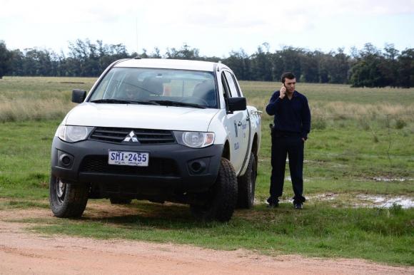 Custodia policial en el campo de Lázaro Báez. Foto: Ricardo Figueredo