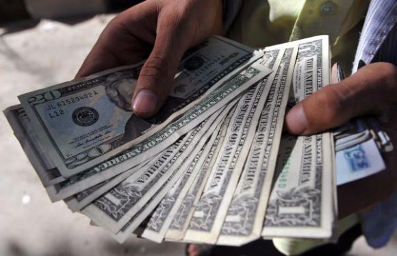 La suba del dólar será una de las consecuencias de la decisión de la Fed. Foto: AFP