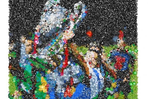 Imagen de Suárez con la copa de la Champions League hecha en el Emoji Mosaic.