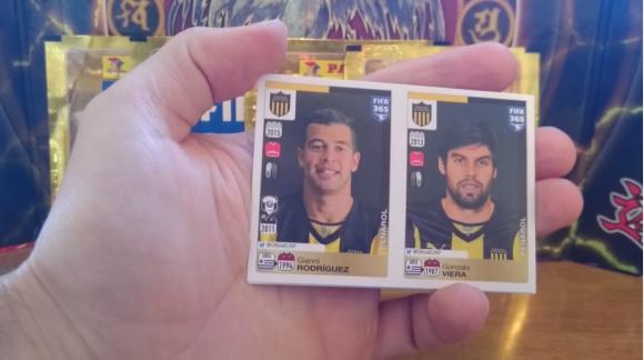 Gianni Rodríguez y Gonzalo Viera, que ya no está, en el Álbum Panini FIFA 365. Foto: captura video Youtube
