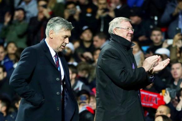 Los entrenadores, Carlo Ancelotti y Alex Ferguson. Foto: Reuters.