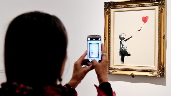 """""""Balloon girl"""". La obra de Banksy fue vendida en 2014 por unos US$ 651.000. (Foto: AFP)"""