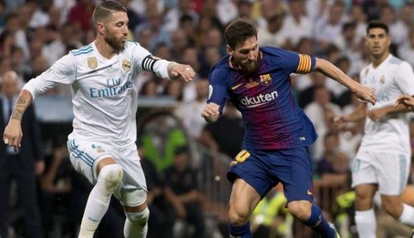 Sergio Ramos y Lionel Messi, futbolistas de la Liga española. Foto: AFP