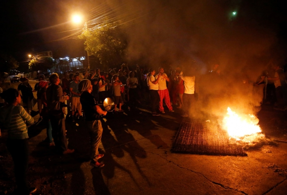 Tegucigalpa: protestas y saqueos en la capital de Honduras. Foto: Reuters