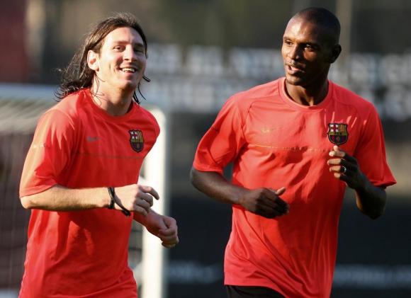 Lionel Messi y Eric Abidal en Barcelona. Foto: AFP