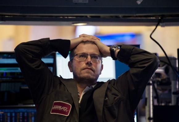 En el peor momento de la sesión, el Dow Jones de Industriales llegó a perder 1.597 puntos. Foto: AFP