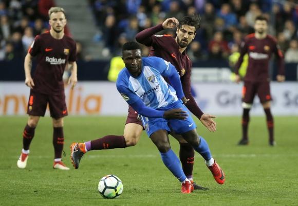 André Gomes en el partido entre Barcelona y Málaga. Foto: AFP