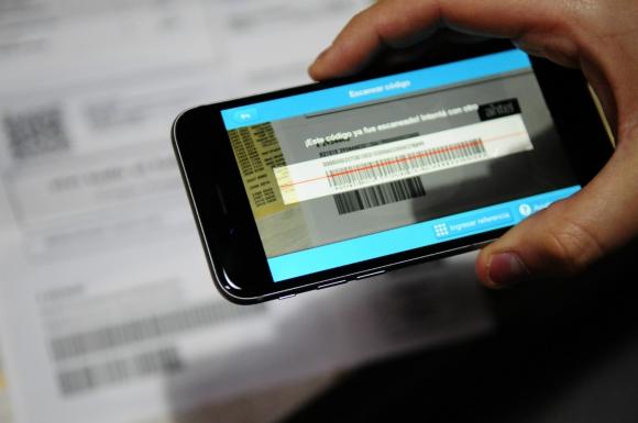 Paganza: en una aplicación que permite -asociada a una cuenta bancaria- pagar las facturas. Foto: M. Bonjour