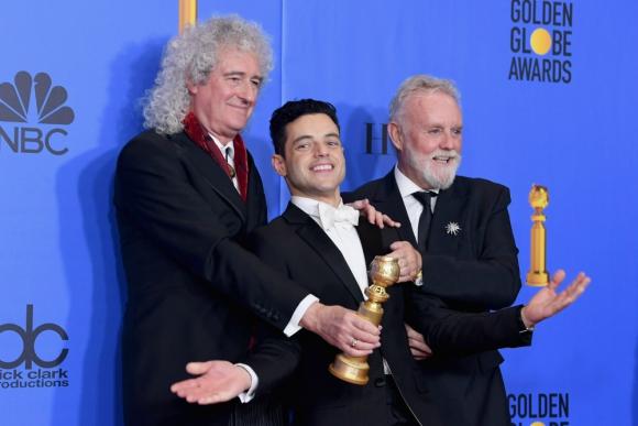 Rami Malek, Roger Taylor, Brian May. Foto: AFP
