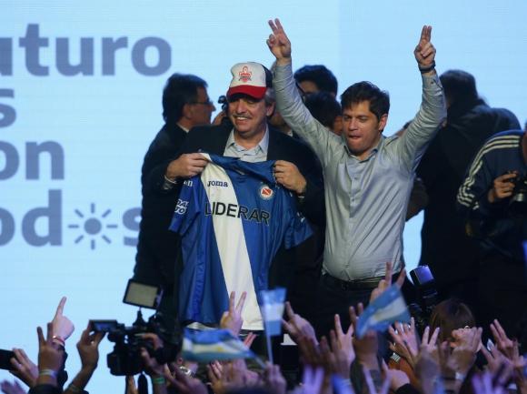 Alberto Fernández y Axel Kicillof tras los resultados de las PASO. Foto: Reuters.