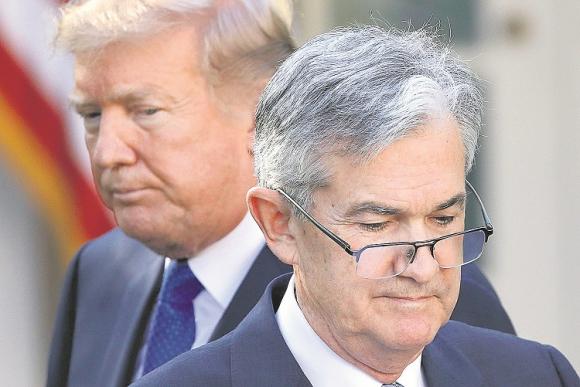 Powell y Donald Trump. Foto: Reuters