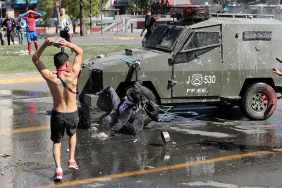 Disturbios en Santiago de Chile. Foto: Reuters.