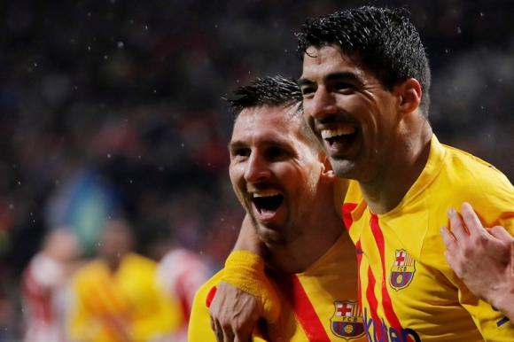 Messi y Suárez festejan el gol en el duelo entre Barcelona y Atlético de Madrid. Foto: Reuters.