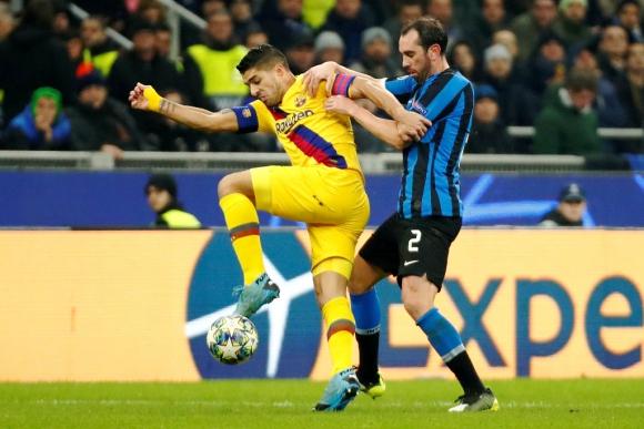 Luis Suárez y Diego Godín en Inter vs. Barcelona