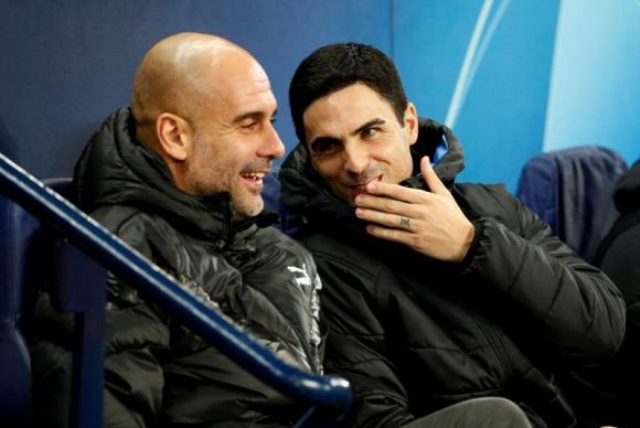 Pep Guardiola y Mikel Arteta. Foto: Reuters.