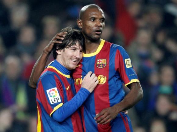 Lionel Messi y Eric Abidal en tiempos en los que competían juntos