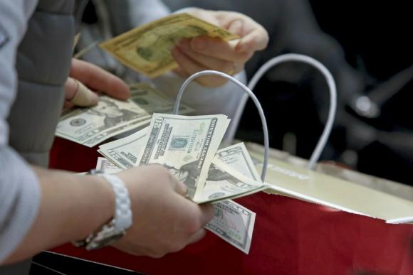 Dólar, dólares. Foto: Reuters