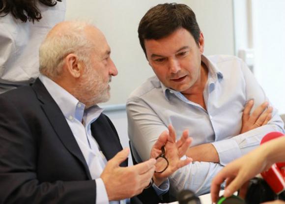 La comisión, integrada por Stiglitz, Piketty y otros, plantea cómo deben ser los impuestos tras el COVID. Foto: AFP