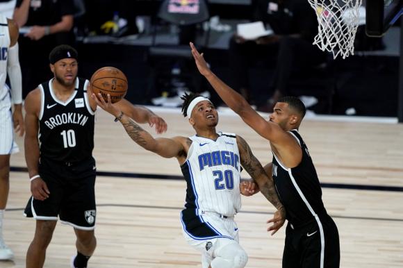 Orlando Magic venció a los Nets en el regreso de la NBA. Foto: AFP.
