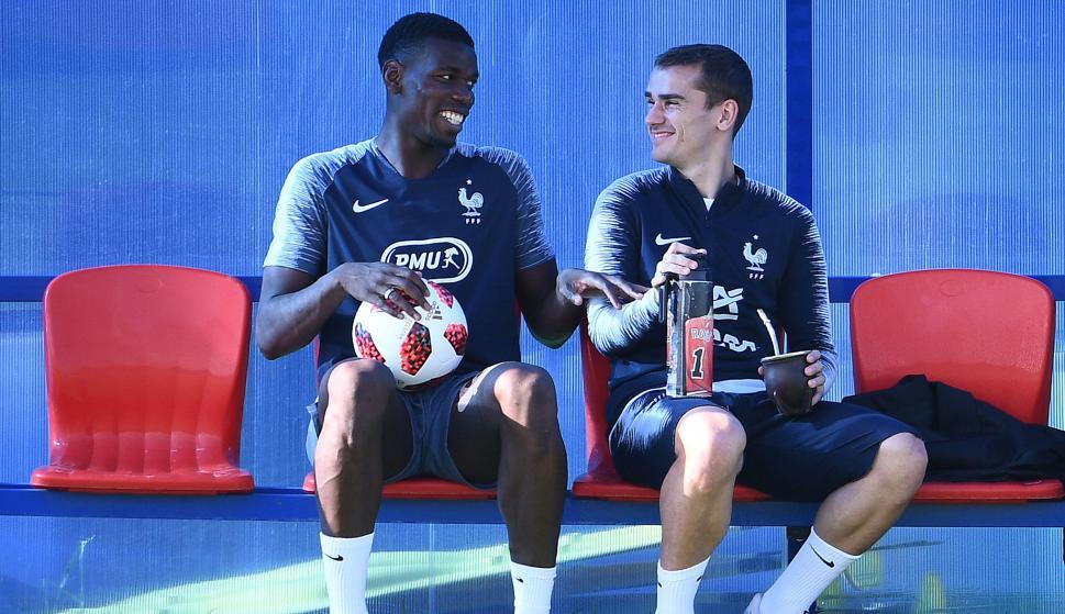 698b0c09472f World Cup winner Antoine Griezmann interrupts teammate Paul Pogba s ...