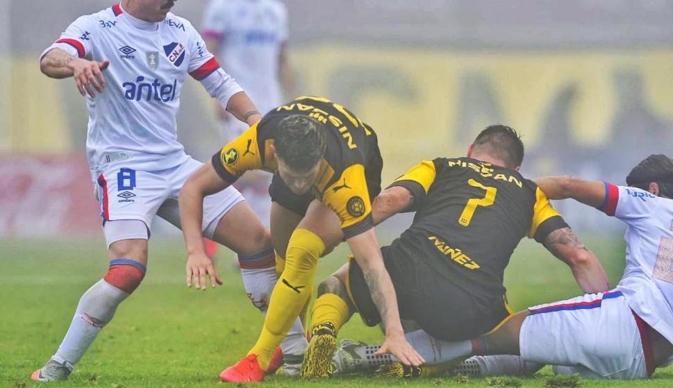 Nacional 1-Peñarol 1: El aurinegro aun con 10 hizo algo más para ...
