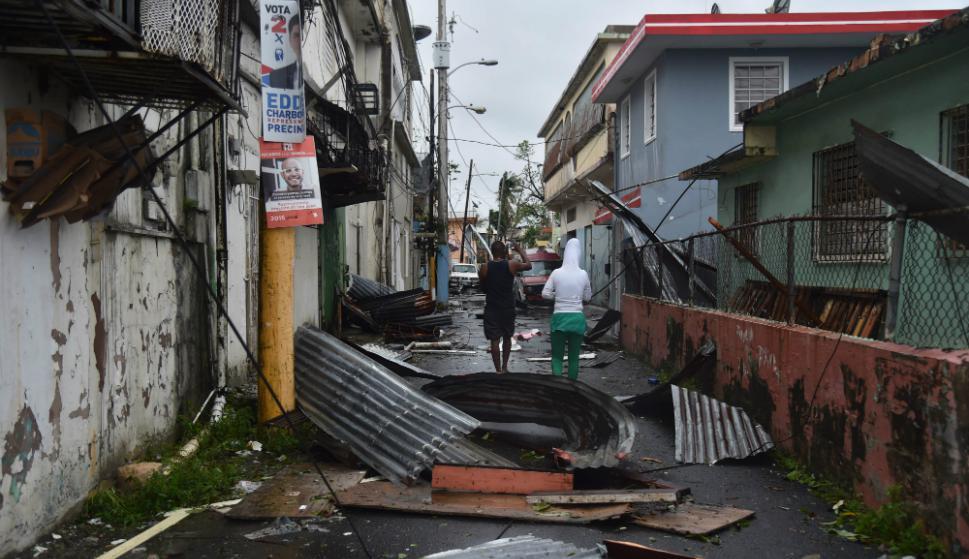 Puertorriqueños se vieron afectados por los daños. Foto: AFP.