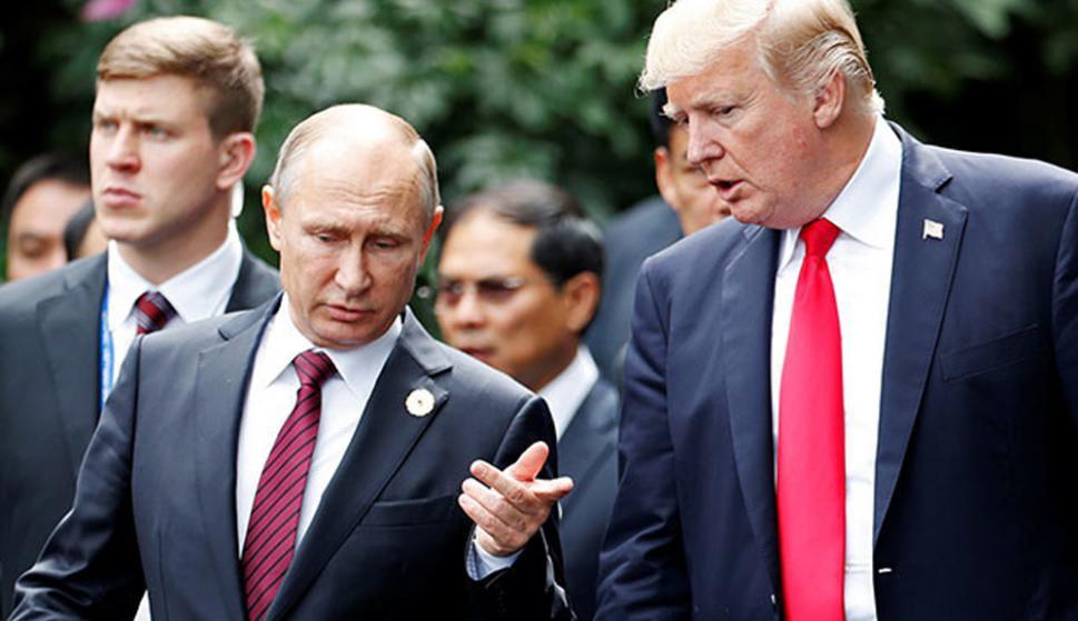 Vladimir Putin y Donald Trump en la última cumbre G20 en Hamburgo. Foto: AFP