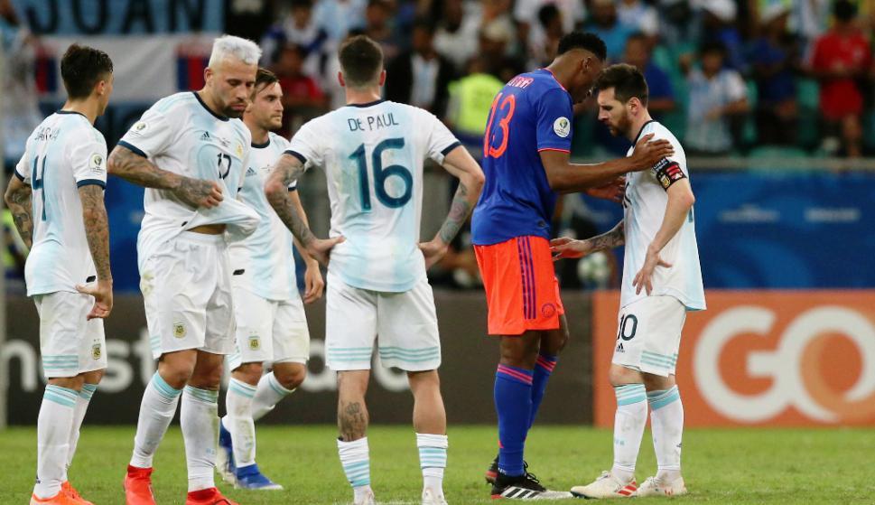Yerri Mina y Lionel Messi
