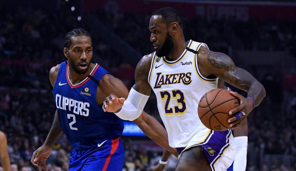 Kawhai Leonard y LeBron James, figuras de la NBA. Foto: AFP.
