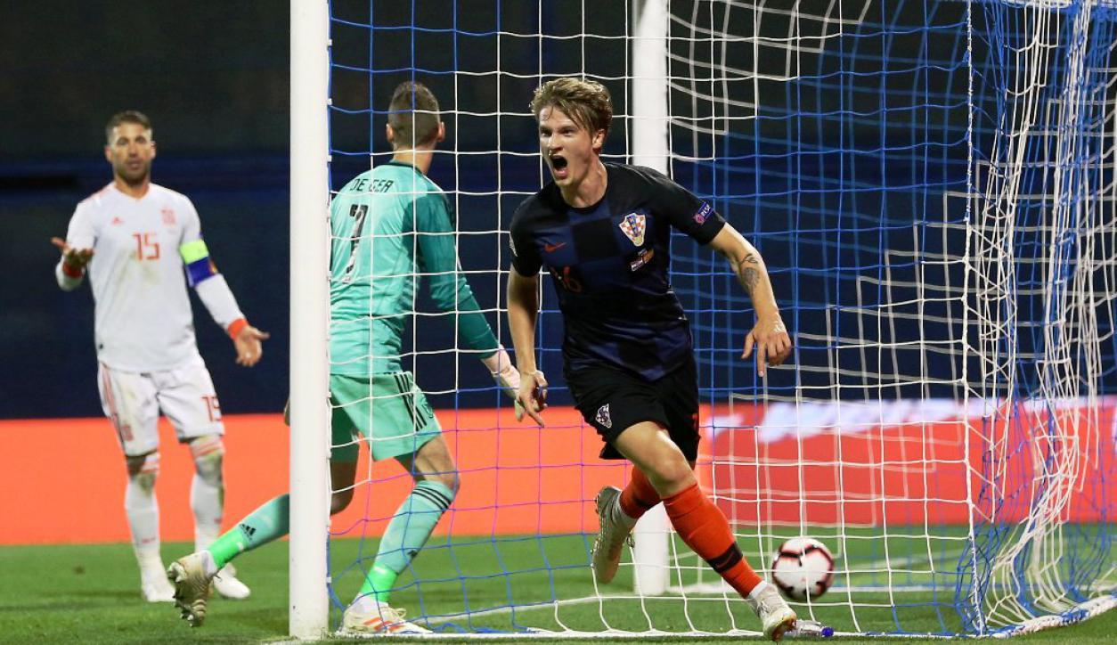 Tin Jedvaj grita uno de sus goles ante España. Foto: Reuters