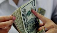 Los dólares que vuelven por el blanqueo pagarán un impuesto especial. Foto: AFP