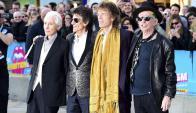 Los músicos fueron a la inauguración de la muestra. Foto: EFE.