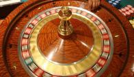 Los juegos de paño pierden más pie ante las tragamonedas. Foto: AFP