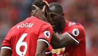 El festejo de Paul Pogba y Romelu Lukaku para el Manchester United. Foto: AFP
