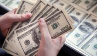 De los 2,1 millones de cuentas bancarias que hay en Uruguay, casi 1,7 millones tiene depósitos por US$ 5.000 o menos. Foto: AFP