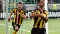 Gastón Rodríguez festeja su gol en el Palmeiras-Peñarol. Foto: AFP
