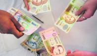 Cuña fiscal es medida de referencia entre costos laborales y salario neto. Foto: F. Ponzetto