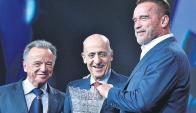 Maglione. El uruguayo junto a Schwarzenegger y Santoja.
