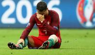 La lesión de Cristiano Ronaldo en Francia-Portugal. Fotos: AFP/Reuters.