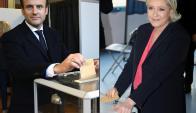 Emmanuel Macron y Marine Le Pen votaron en el día final de las elecciones. Foto: AFP