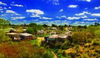 A las viviendas de emergencia, Techo suma obras de saneamiento y enseñanza de oficios. Foto: Techo