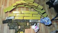 24 kilos de marihuana prensada se hallaron en  Solymar. Foto: Ministerio del Interior