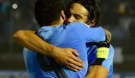 Suárez y Cavani. Foto: AFP